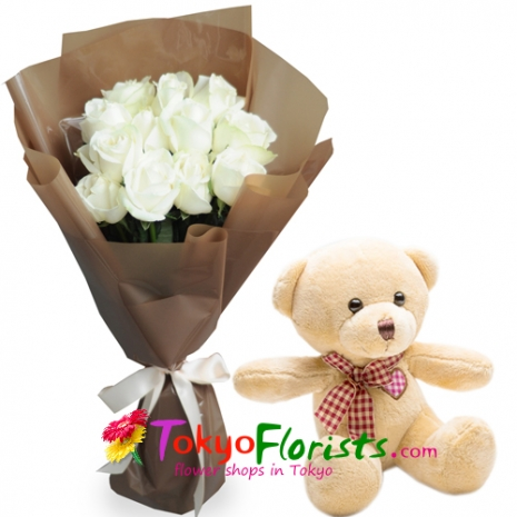 send a soft cuddly teddy bear with white roses in a bouquet to tokyo
